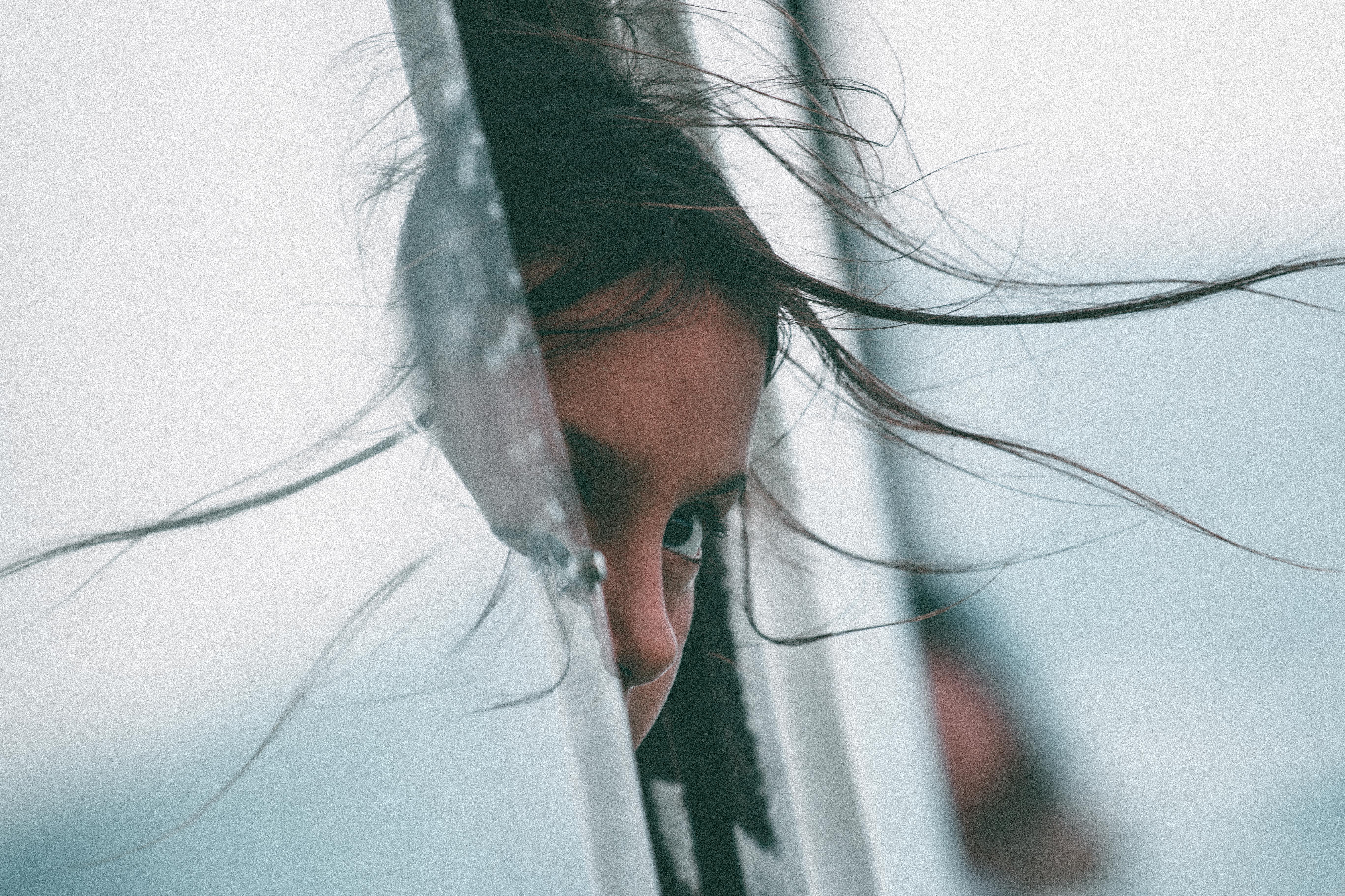 girl sticking her head in car of window