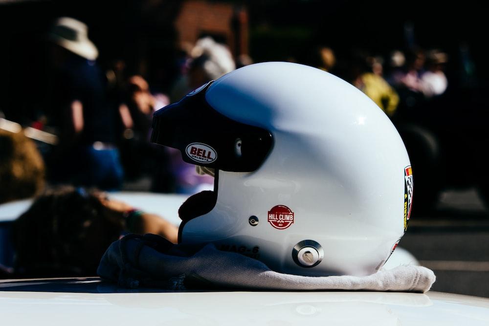 white Bell helmet on white garment on the table