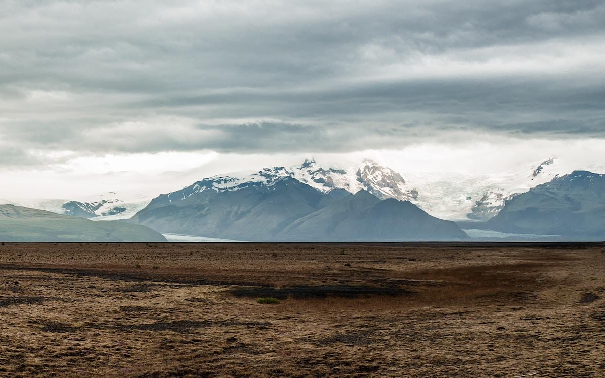 snowcap mountain under cloudy sky taken at daytime