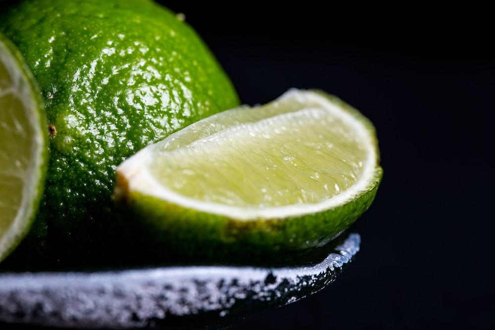 sliced lime on grey bowl
