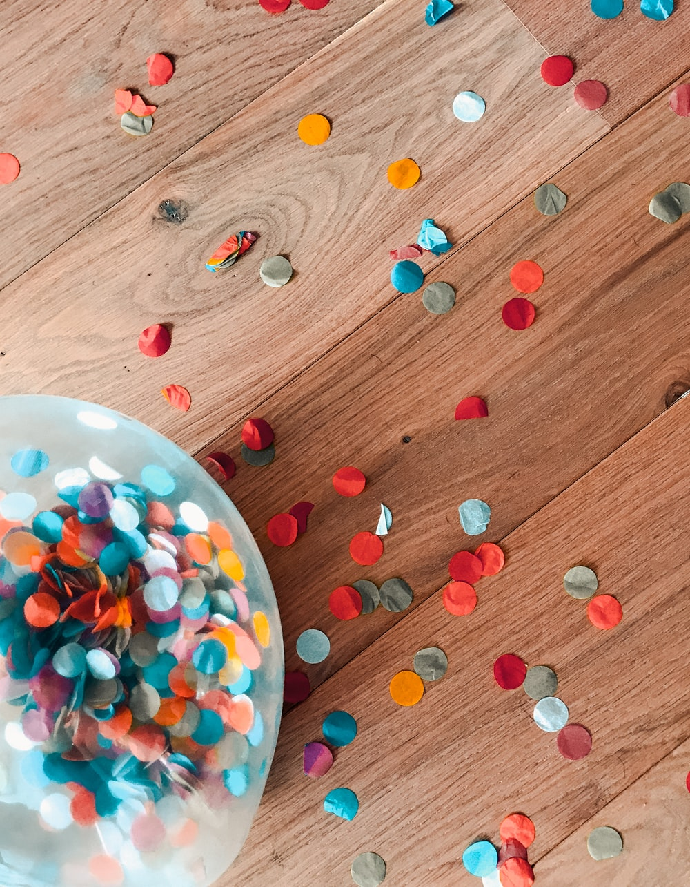 assorted-color of sprinkle dots on brown floor