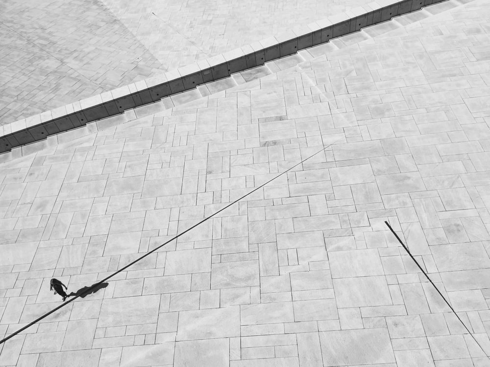 person walking on gray concrete pavement