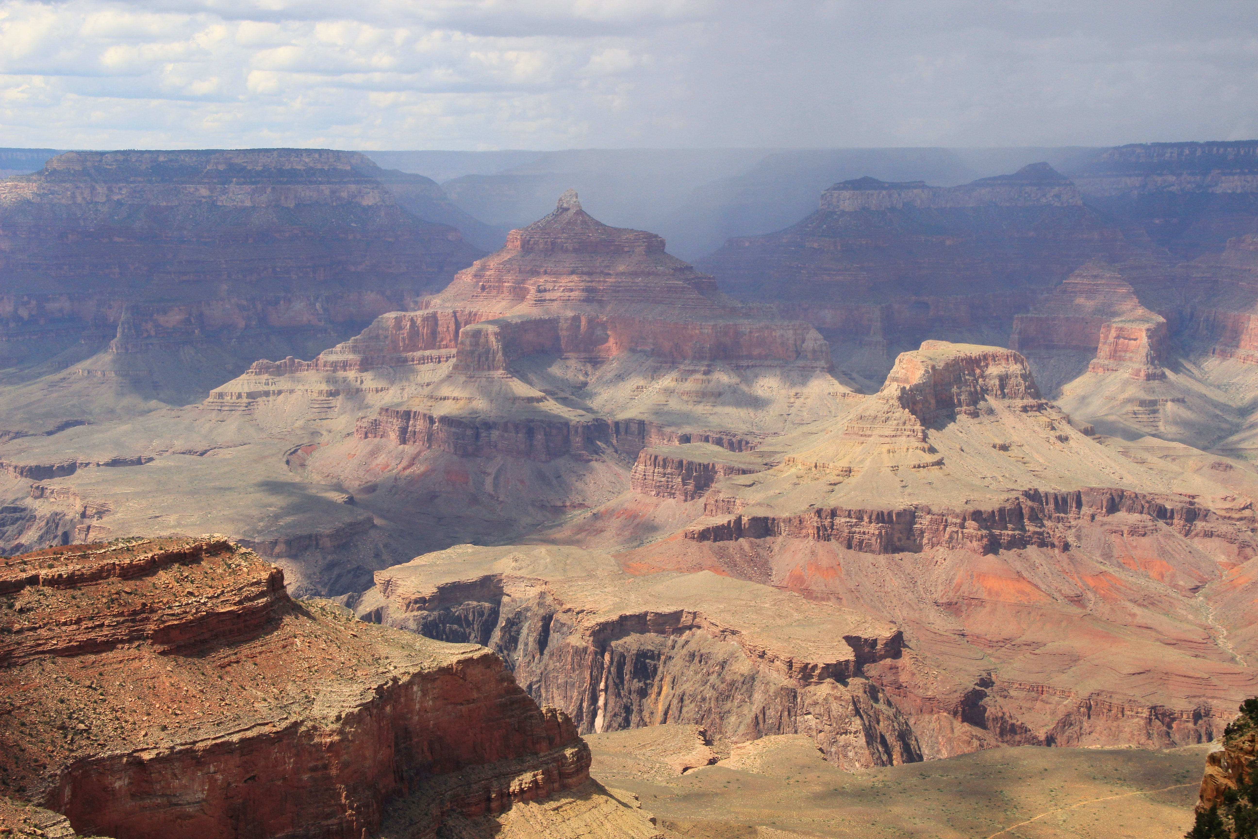 Grand Canyon landscape with orange mountain peaks and rocky valleys
