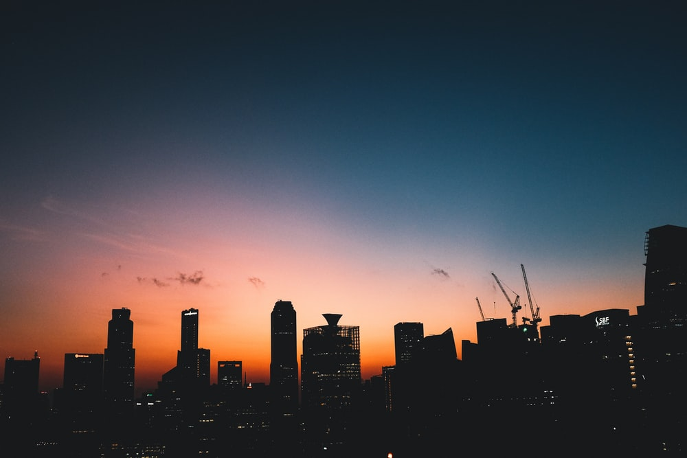 silhouette of high rise buildings during golden hour photography