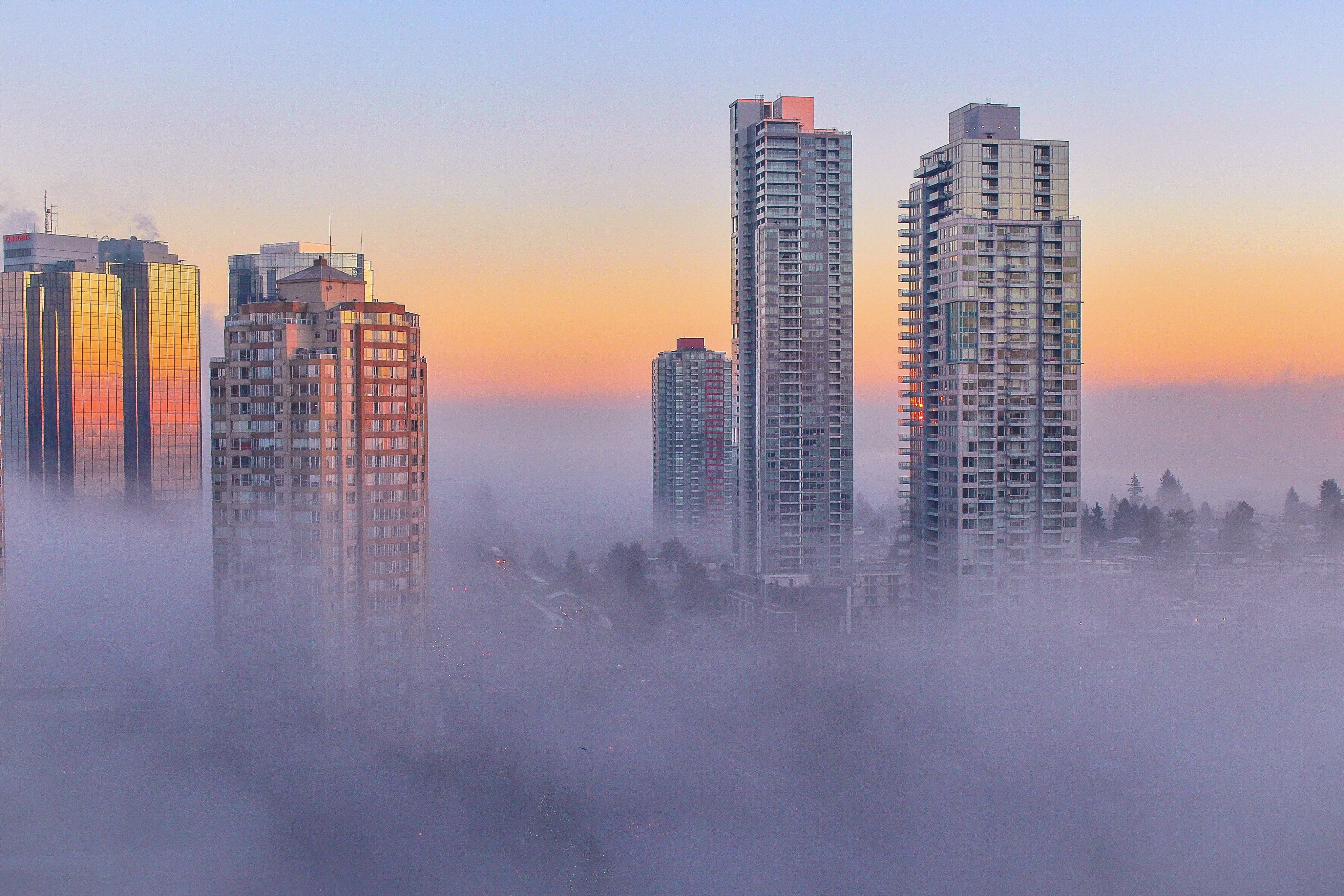 Buildings poking out of fog and sunset in Burnaby