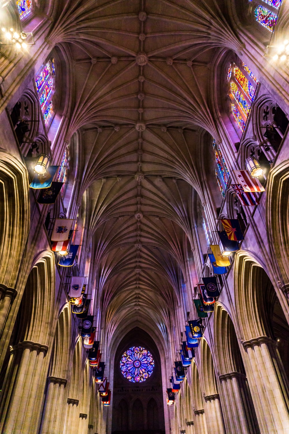 Low Angle Shot Interior Photography Of Cathedral With Multicolored Stained Glass Windows