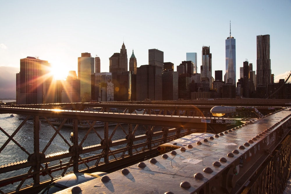 gray metal bridge over sunny morning