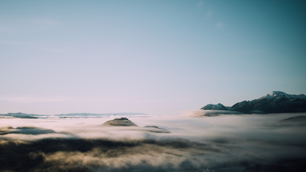 landscape photography of mountains covered with clouds