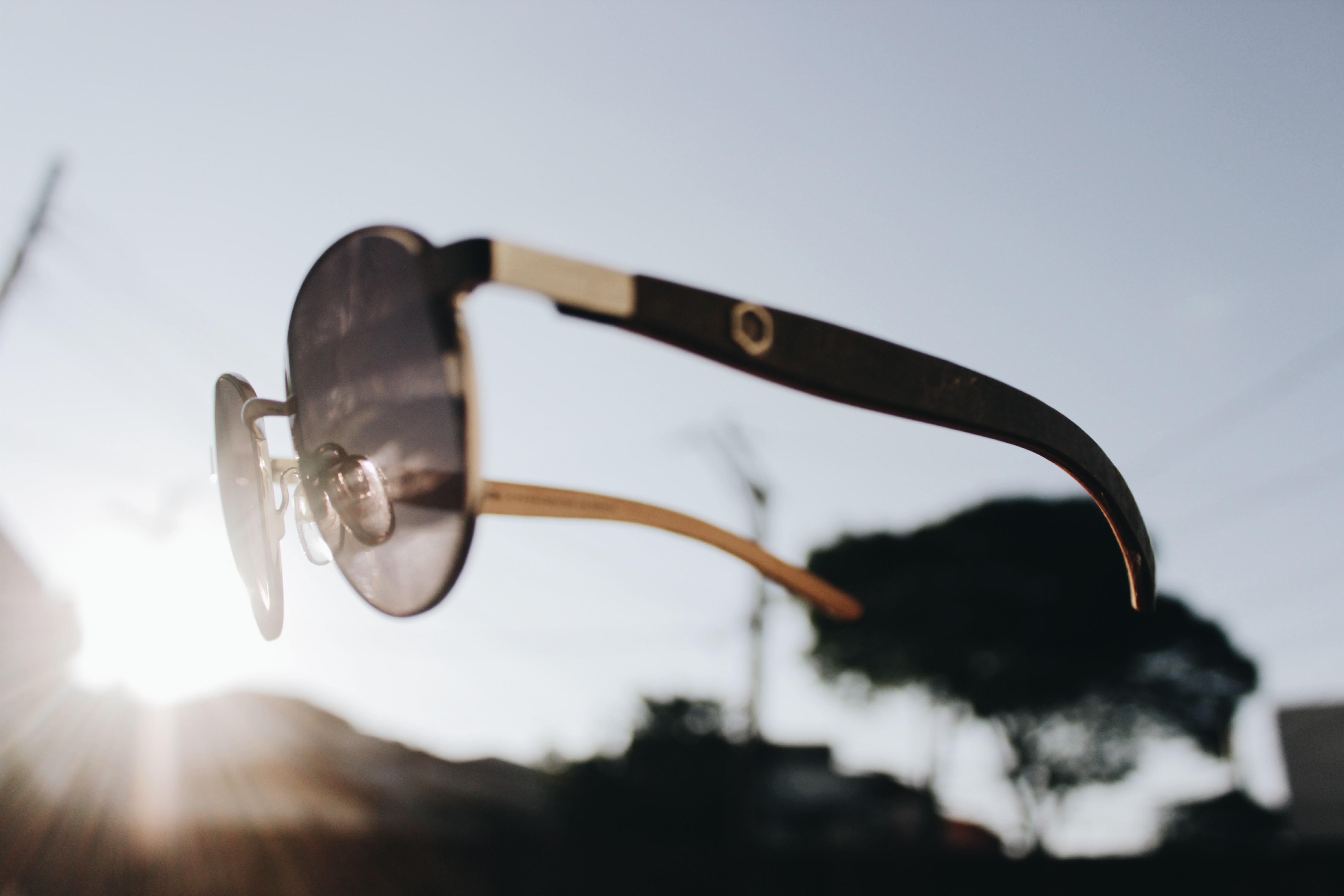 floating black and silver Aviator sunglasses