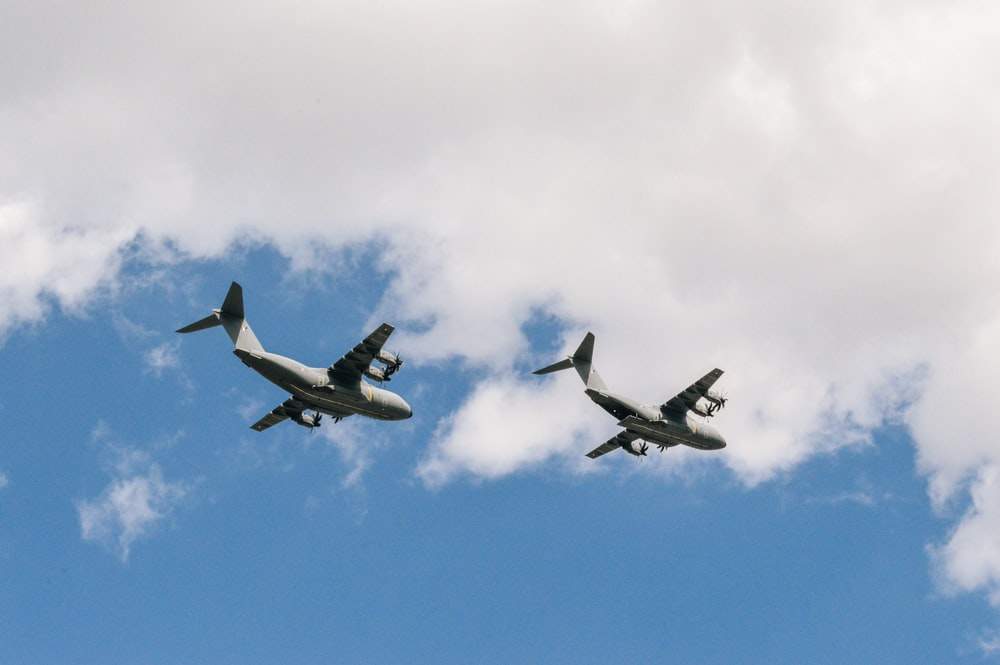 two white planes flying