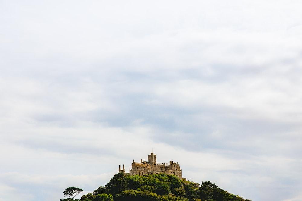 concrete castle on top of mountain