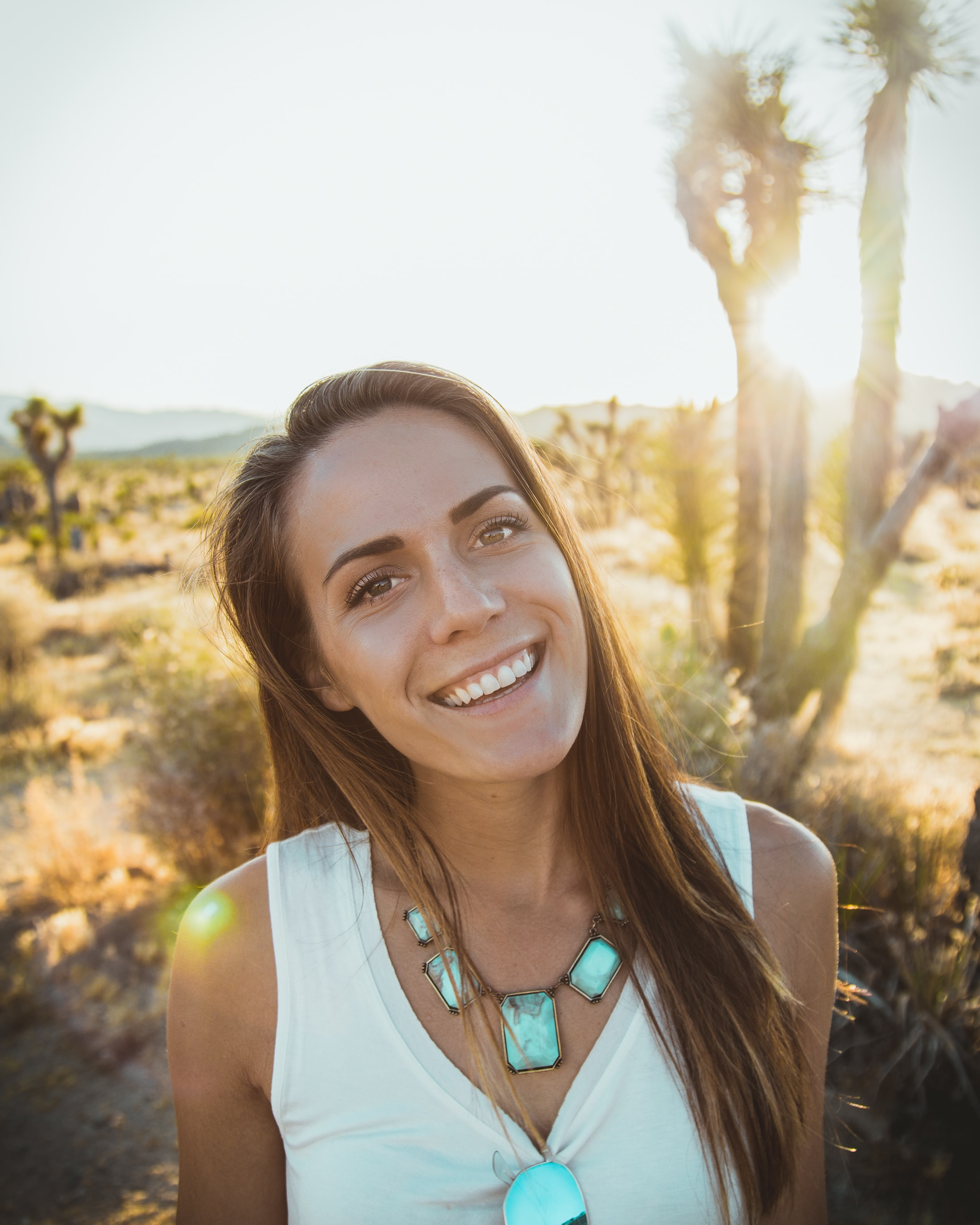 Portrait of a smiling happy woman alone in the desert