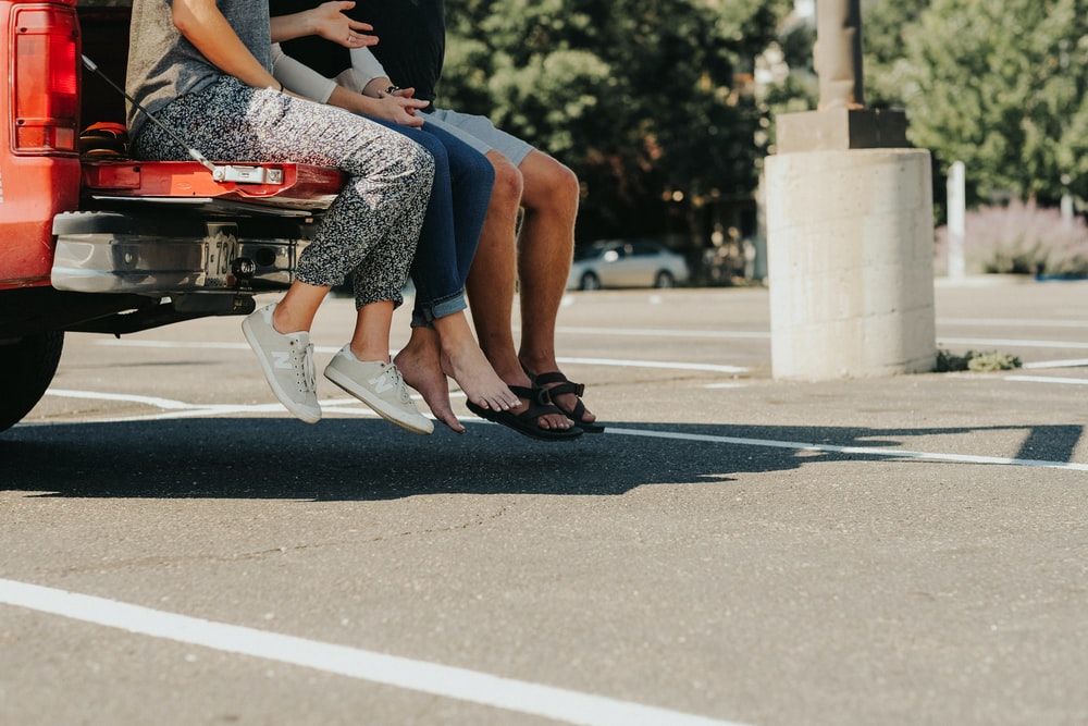 group of people sitting on truck bed