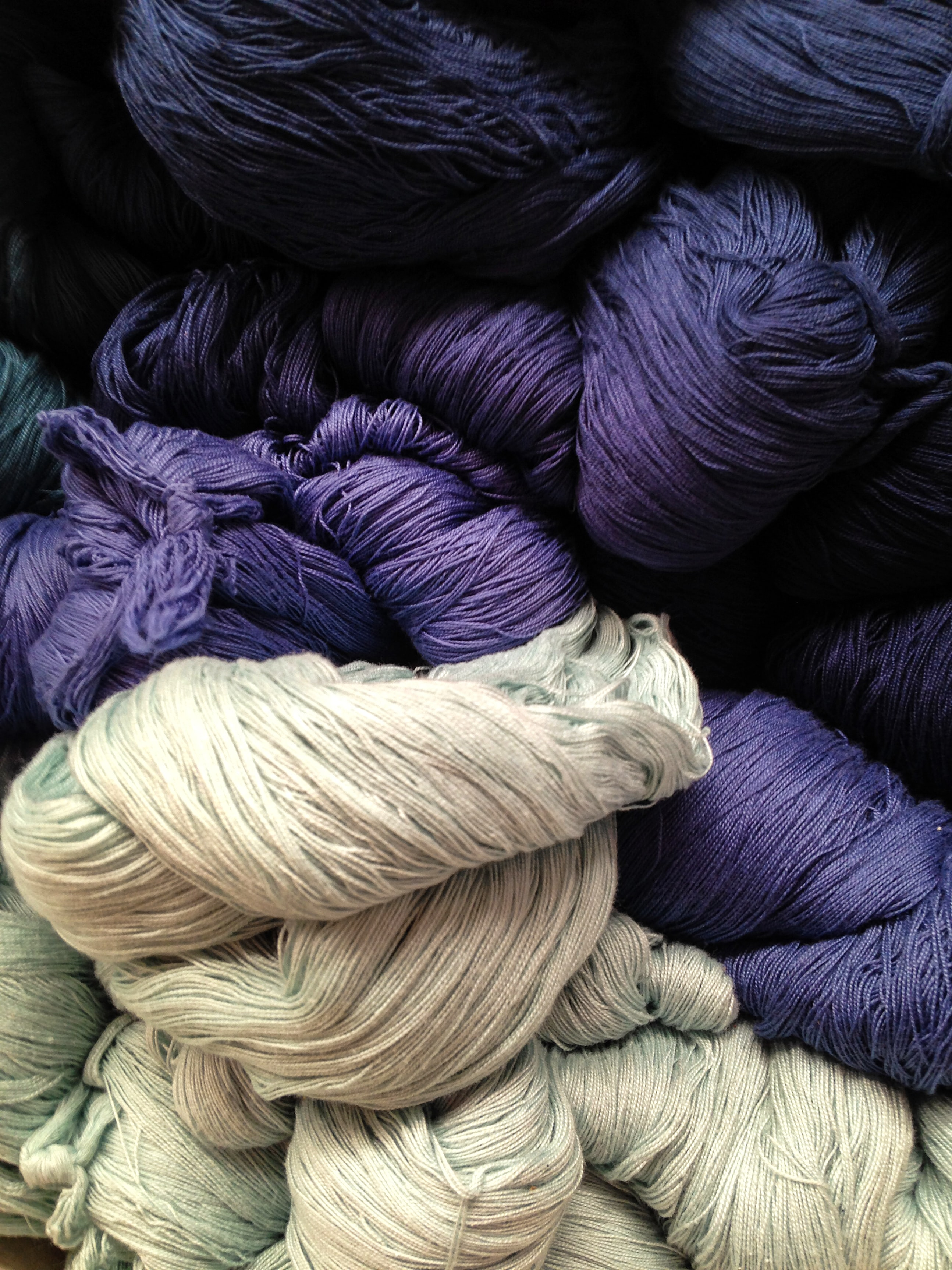 gray and purple yarns