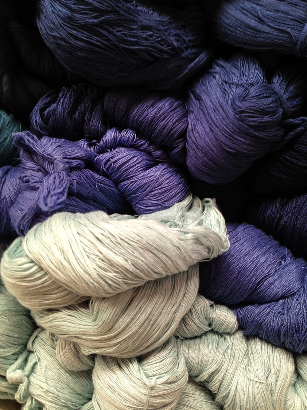 gray and purple yarns