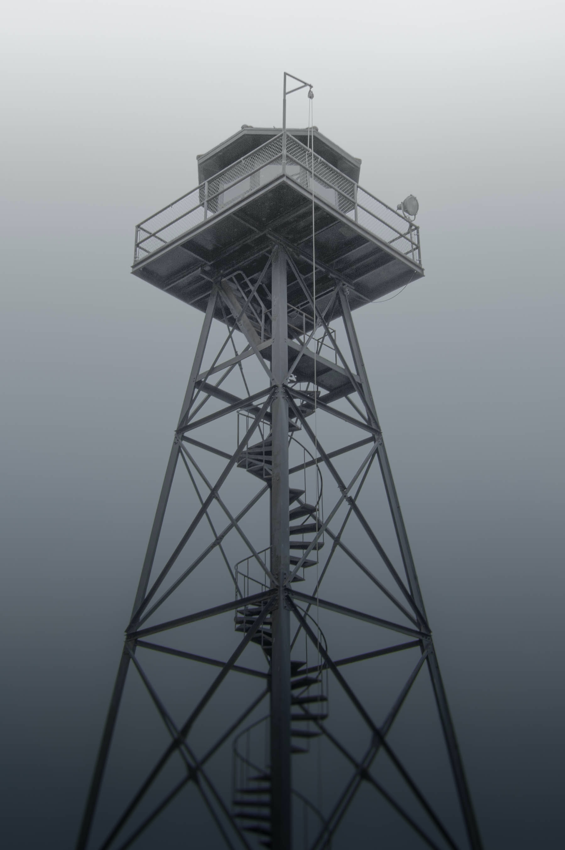 gray metal tower with curve stairs