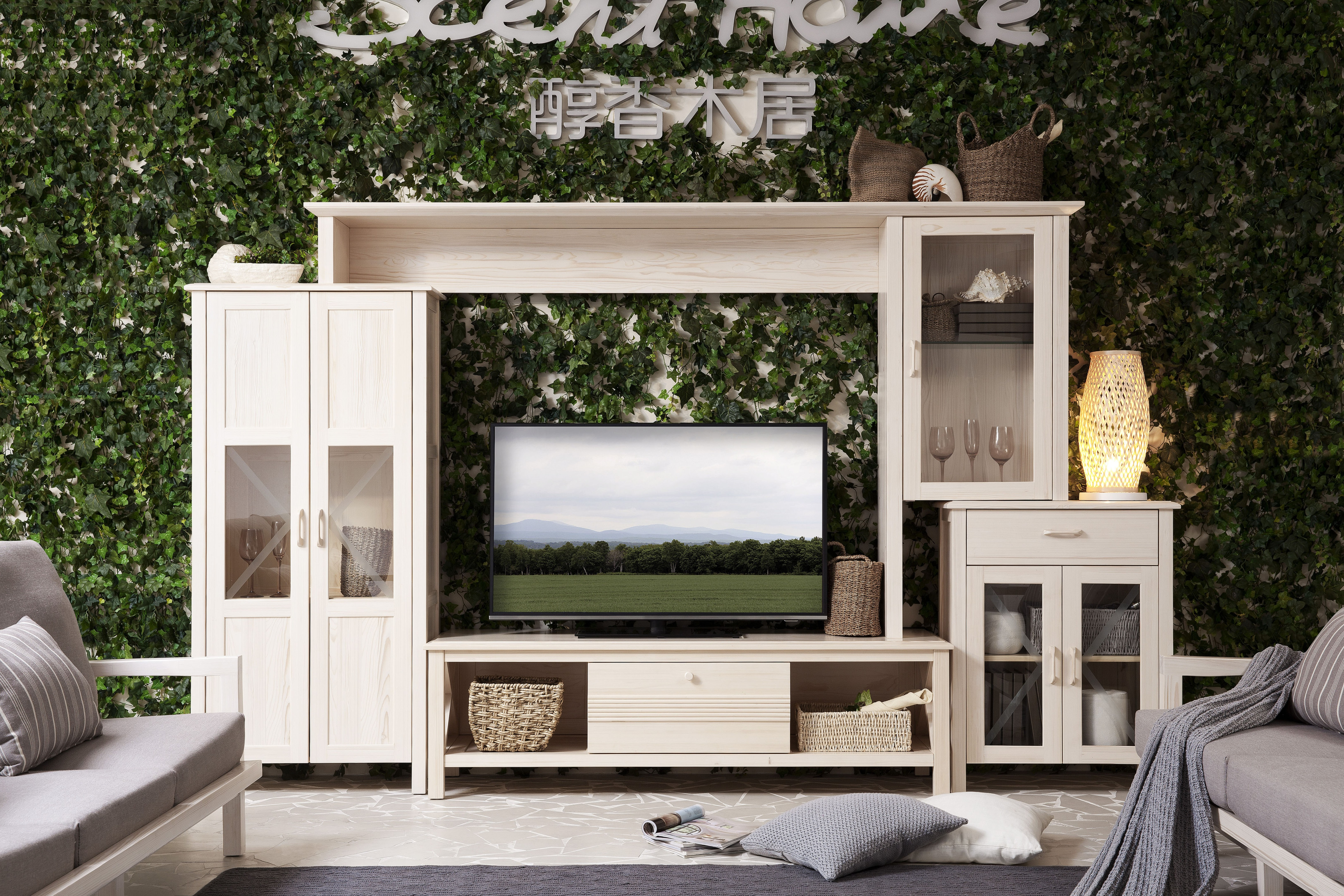 turned on TV on white wooden TV hutch near sofas