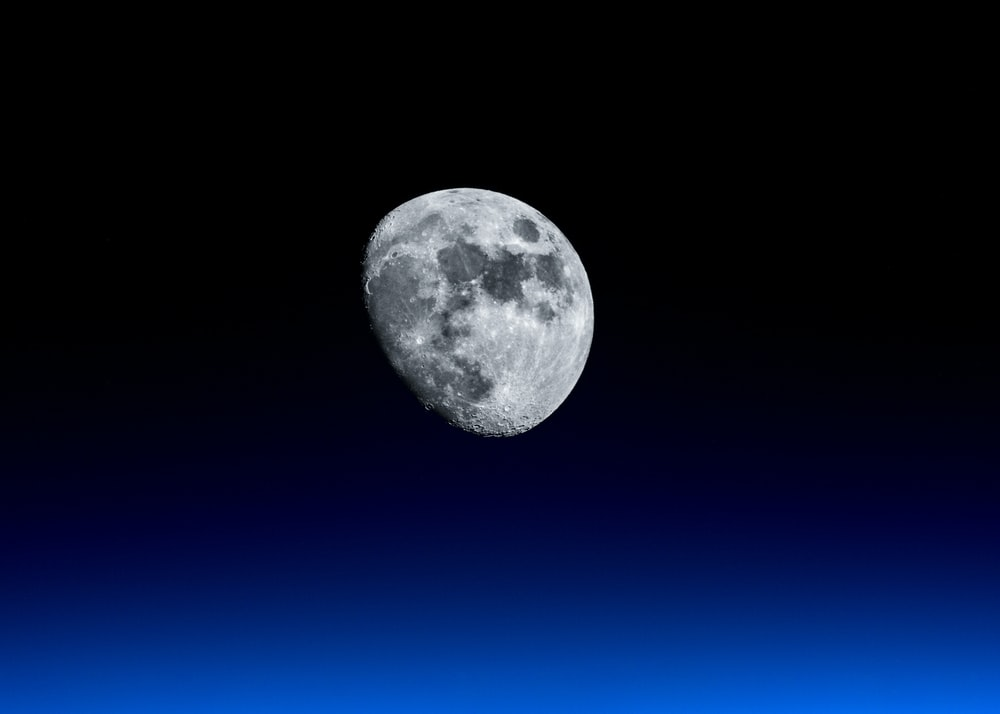 waning moon with black background