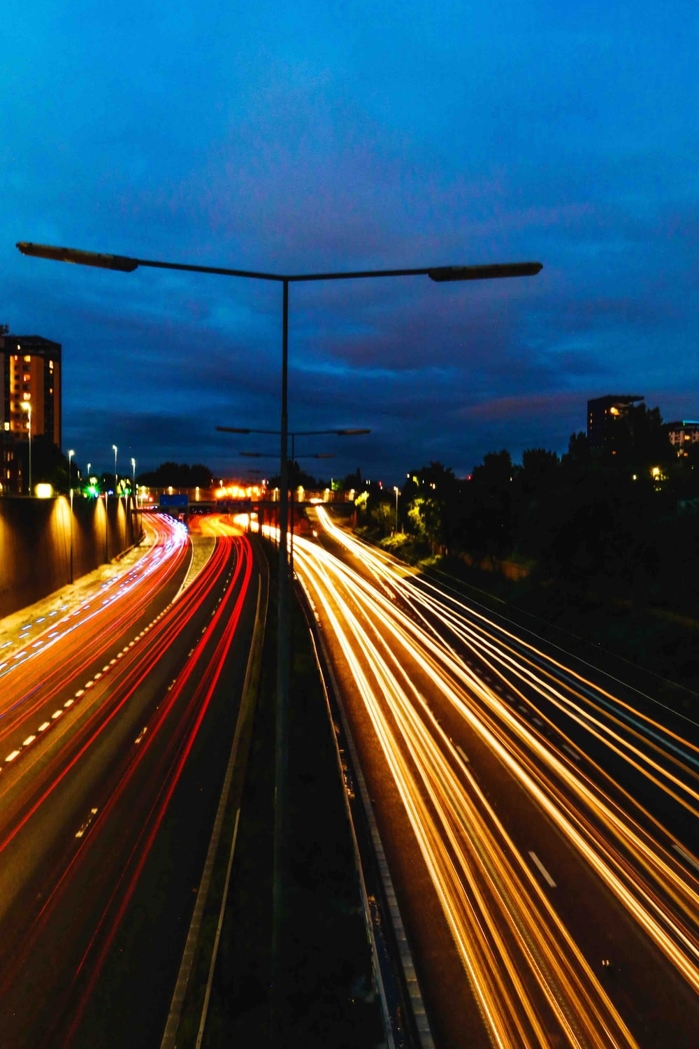 time lapse photography of passing cars on road during nighttime