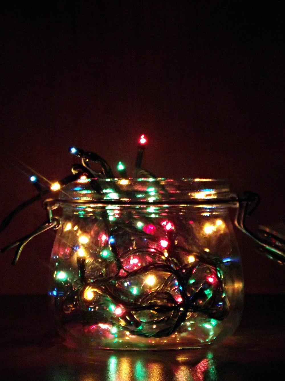 A glass jar containing Christmas tree lights.