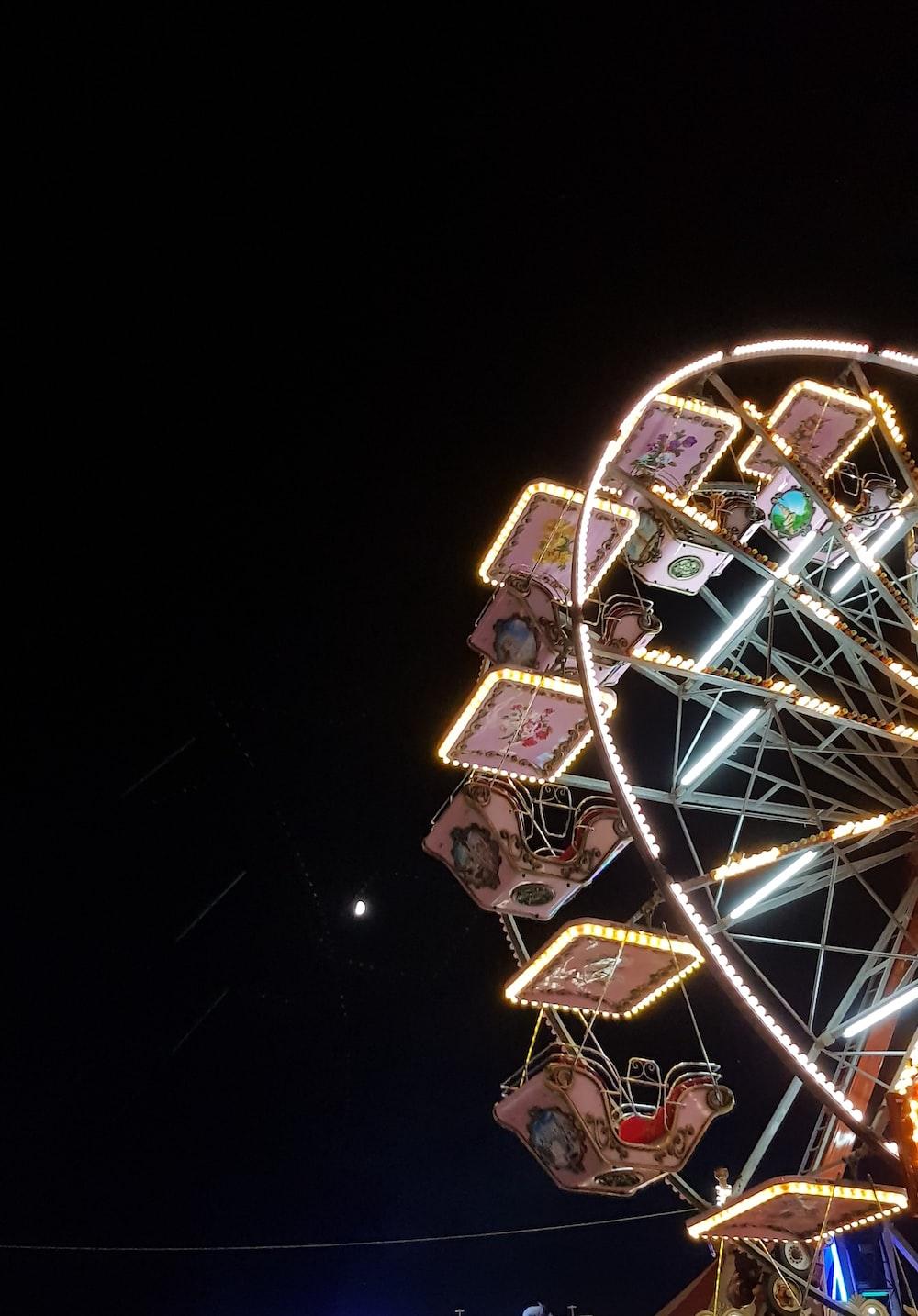 lit ferris wheel during night