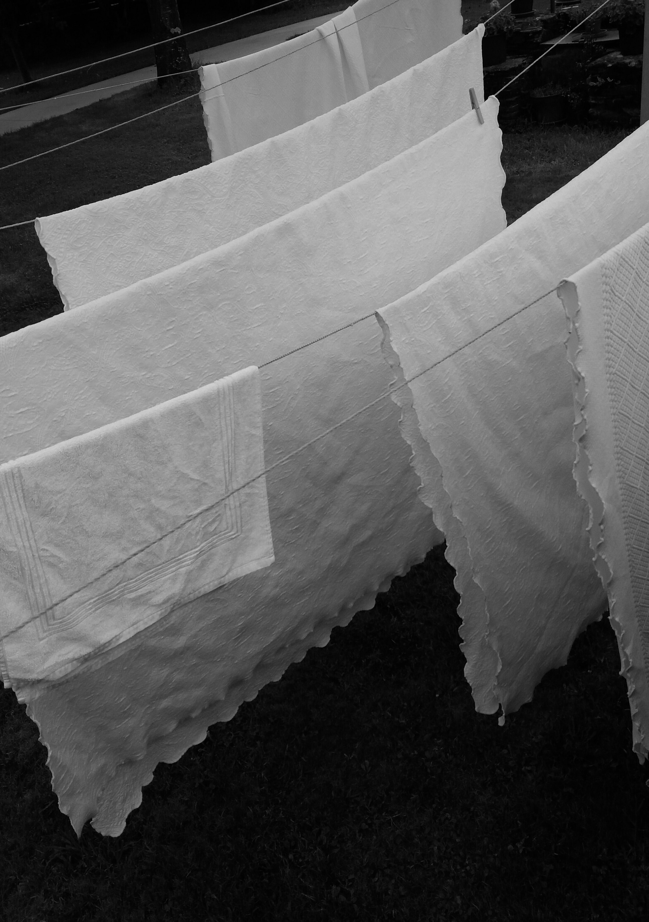 white textile on gray wire clothes hanger