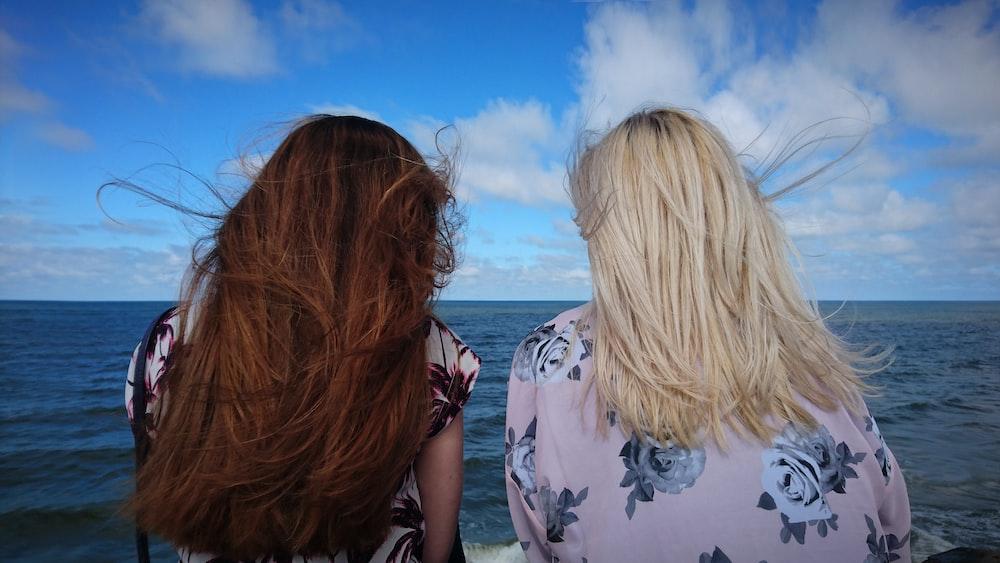 photography of two women seeing horizon during daytime