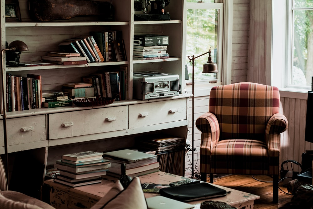 Pictures Living Room. Living room interior filled with books on the table and bookshelf a  plaid chair 100 Room Pictures Download Free Images Unsplash