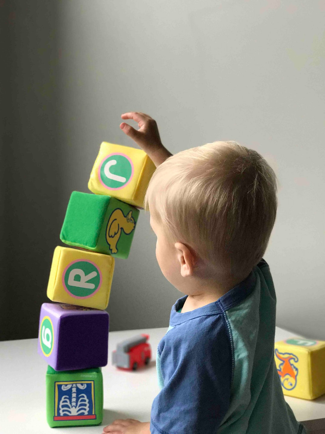 Baby building stack of blocks