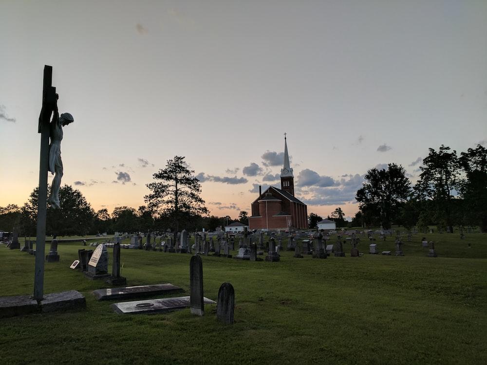 brown church near cemetery