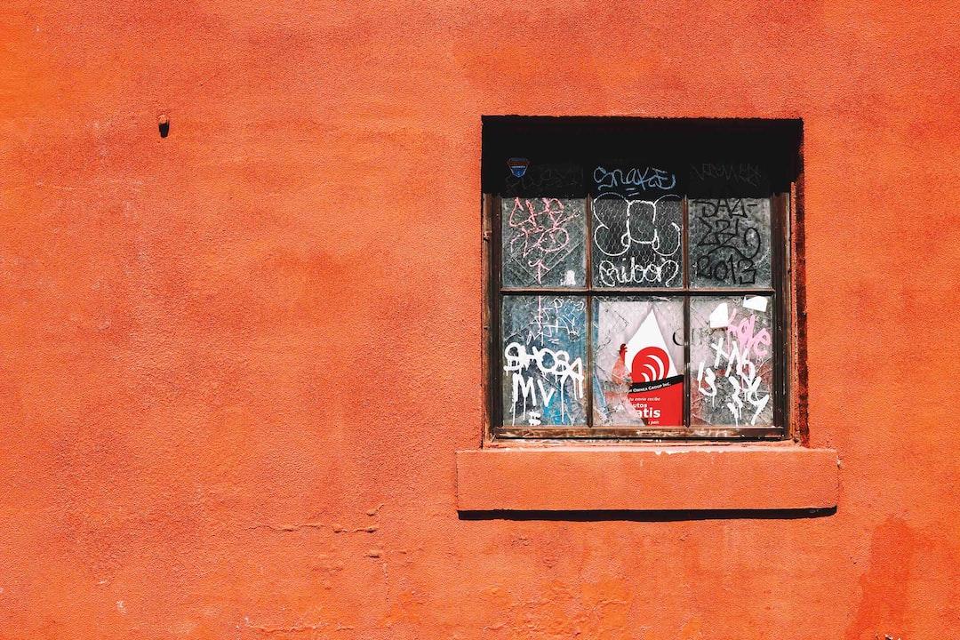 orange broken window graffiti
