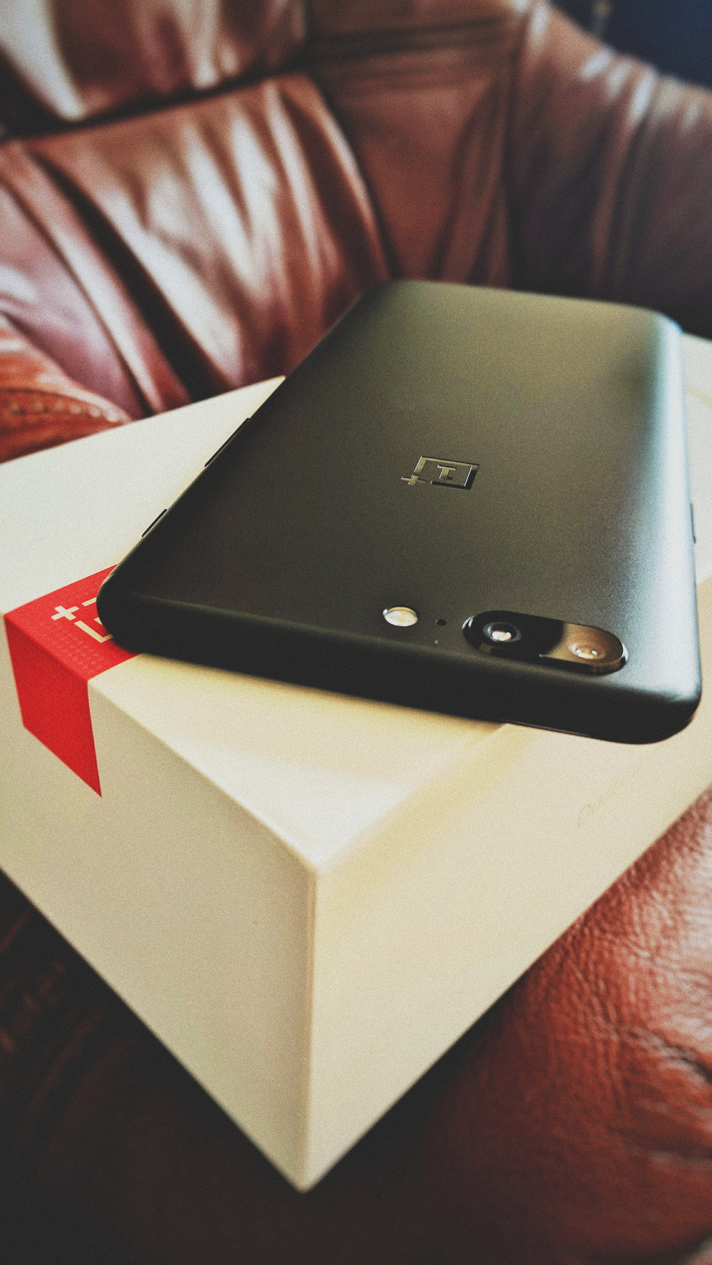 A black smartphone out of its box.