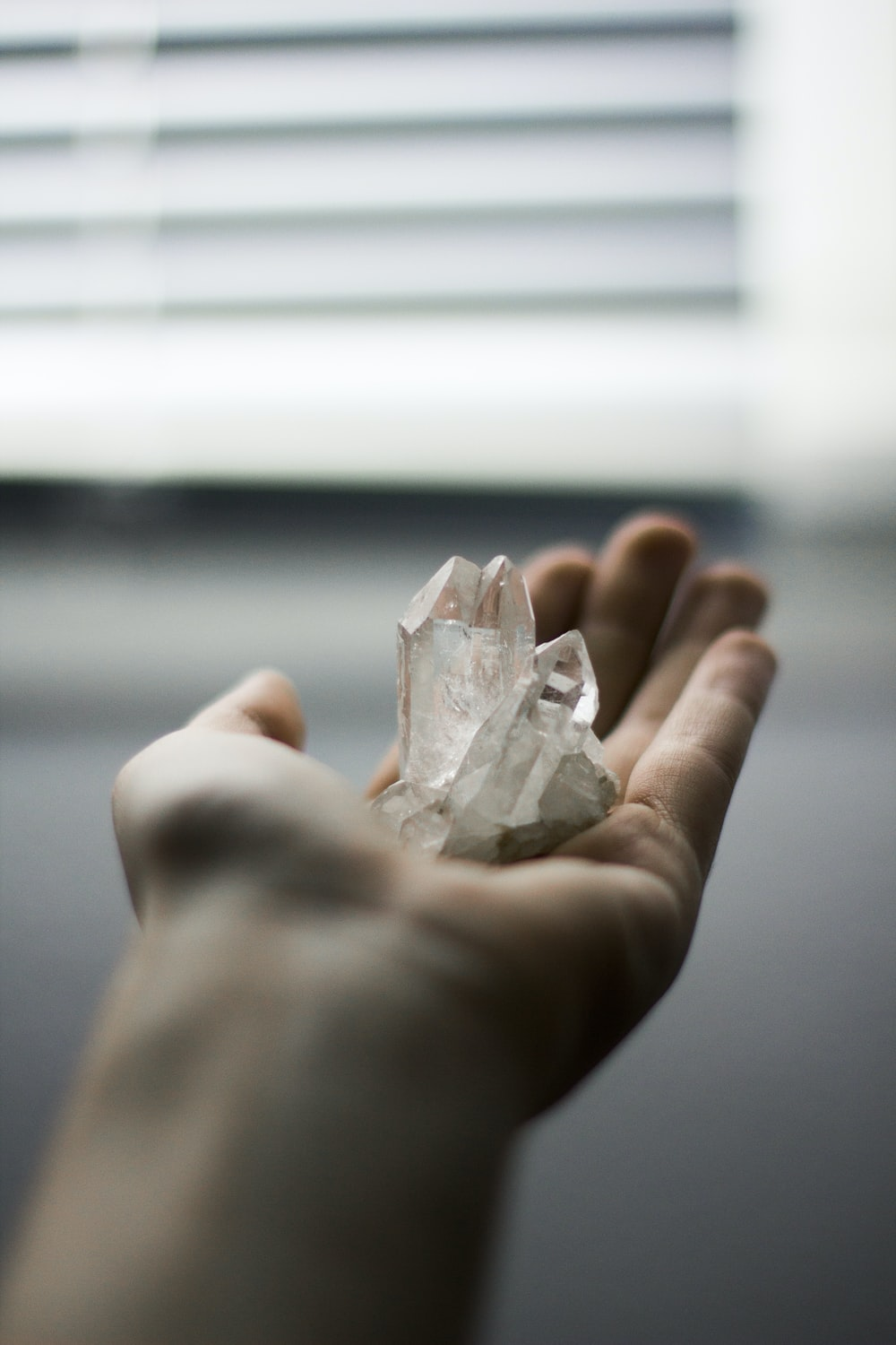person holding crystal stones