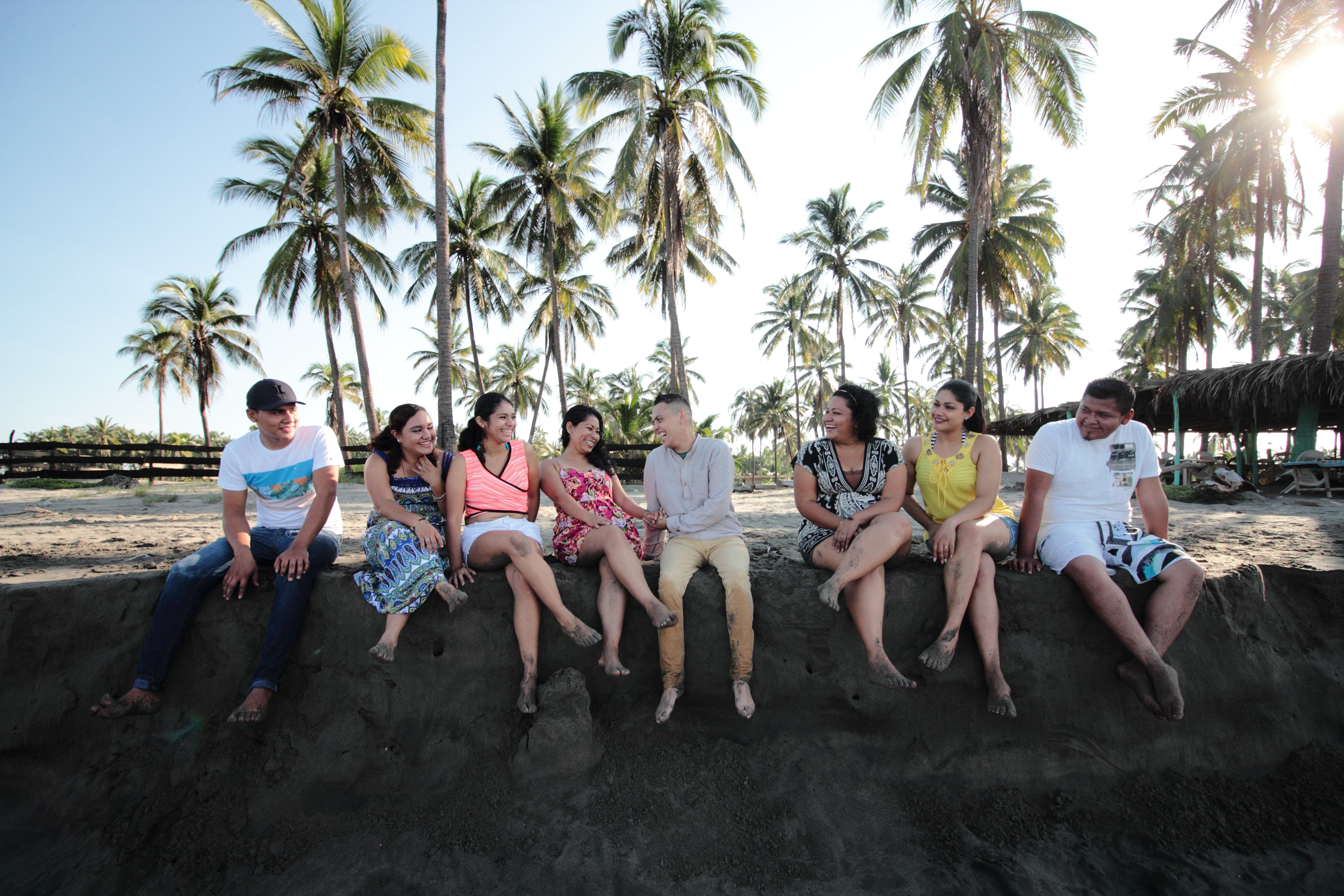 group of people sitting on san