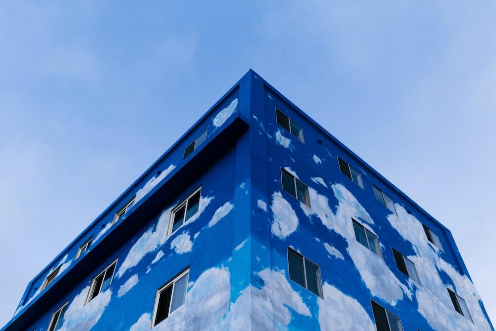 blue high-rise building under blue sky