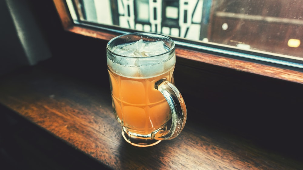 clear glass tankard with beverage