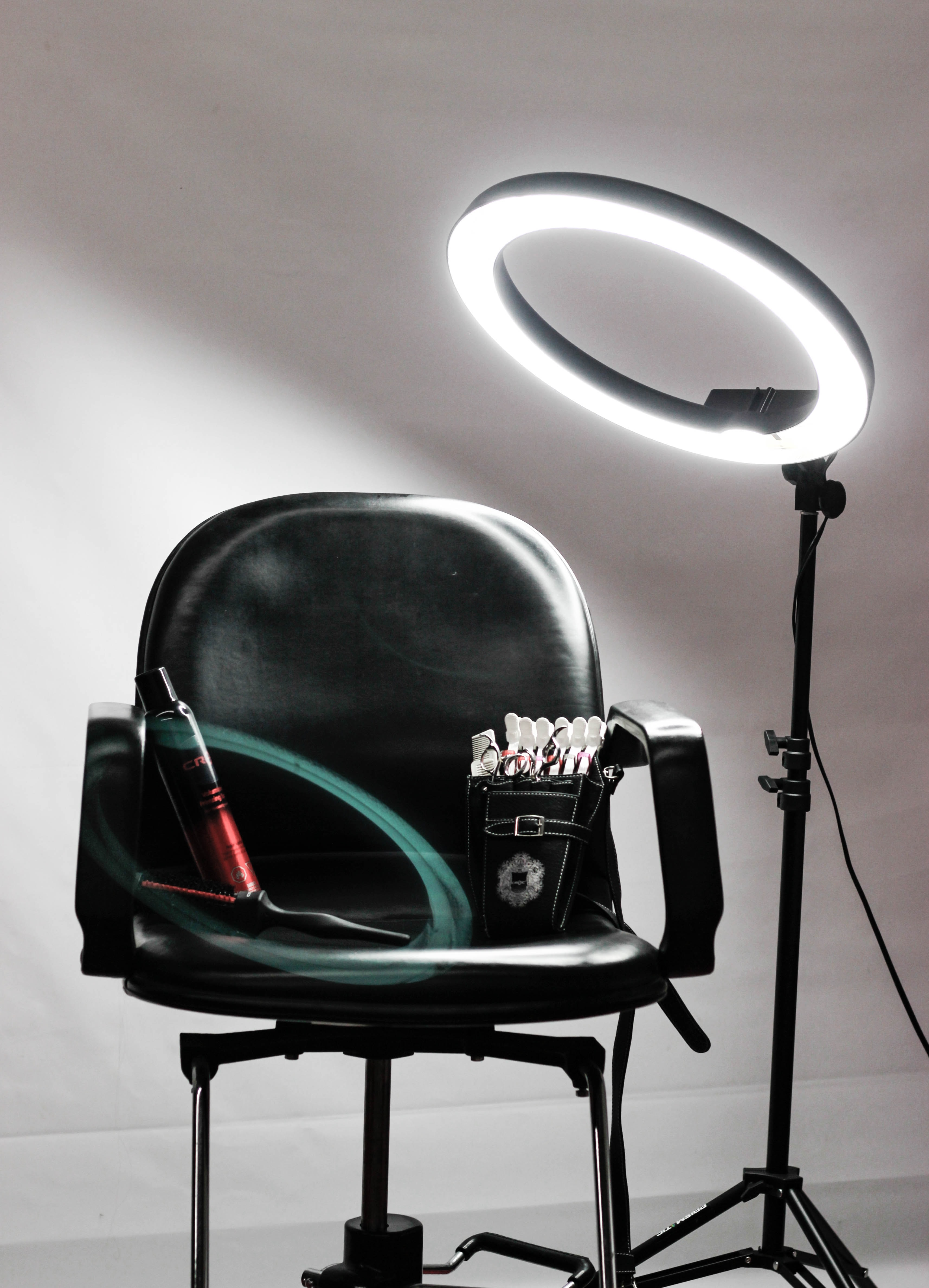 A black leather director's chair with a halo spotlight in Los Angeles