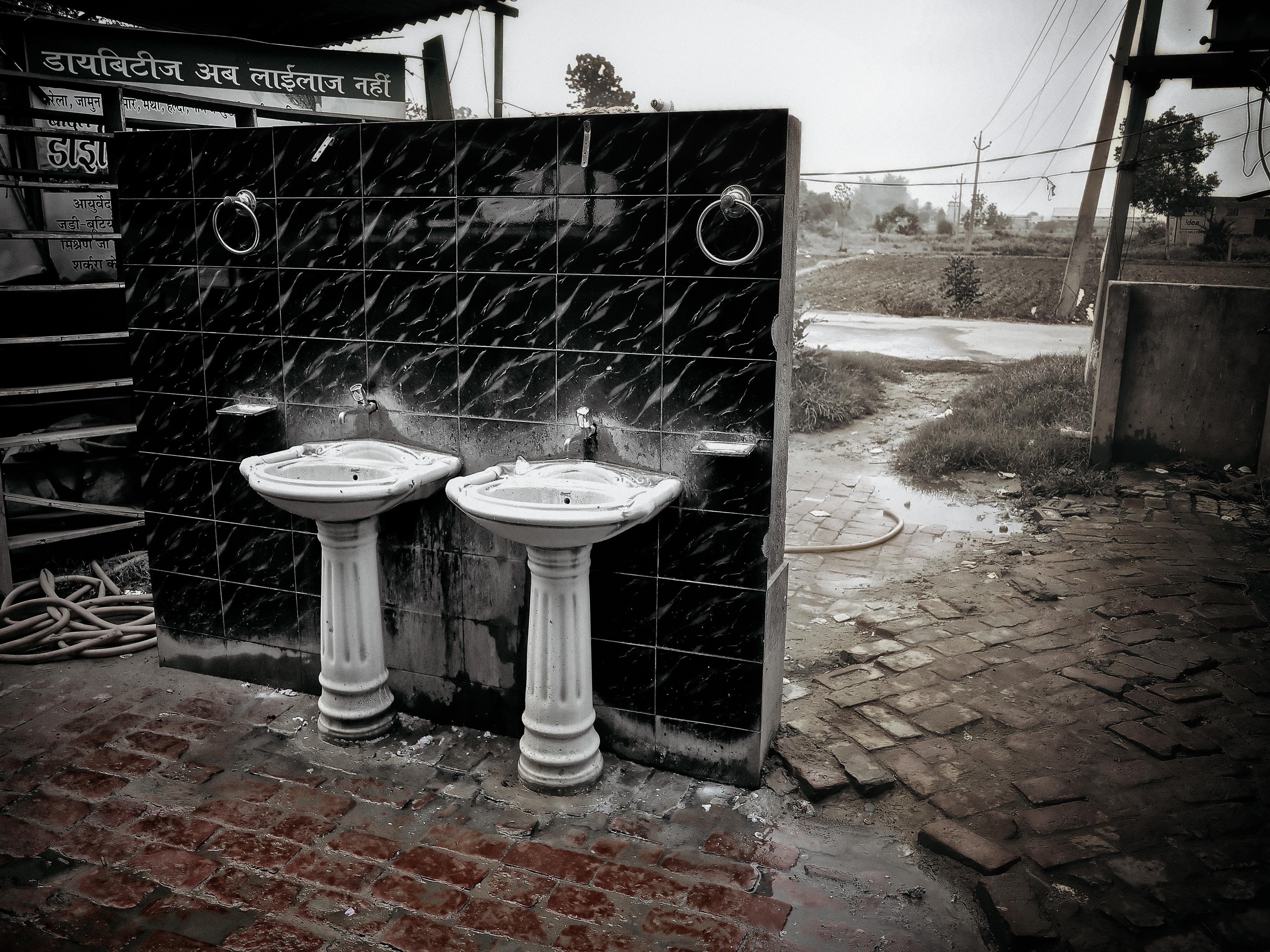Two bathroom sinks outside.