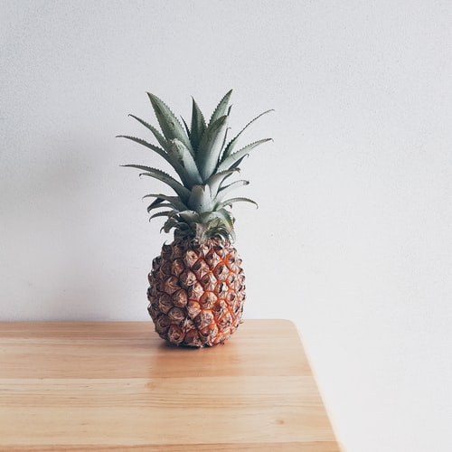 a pineapple sitting on a table.