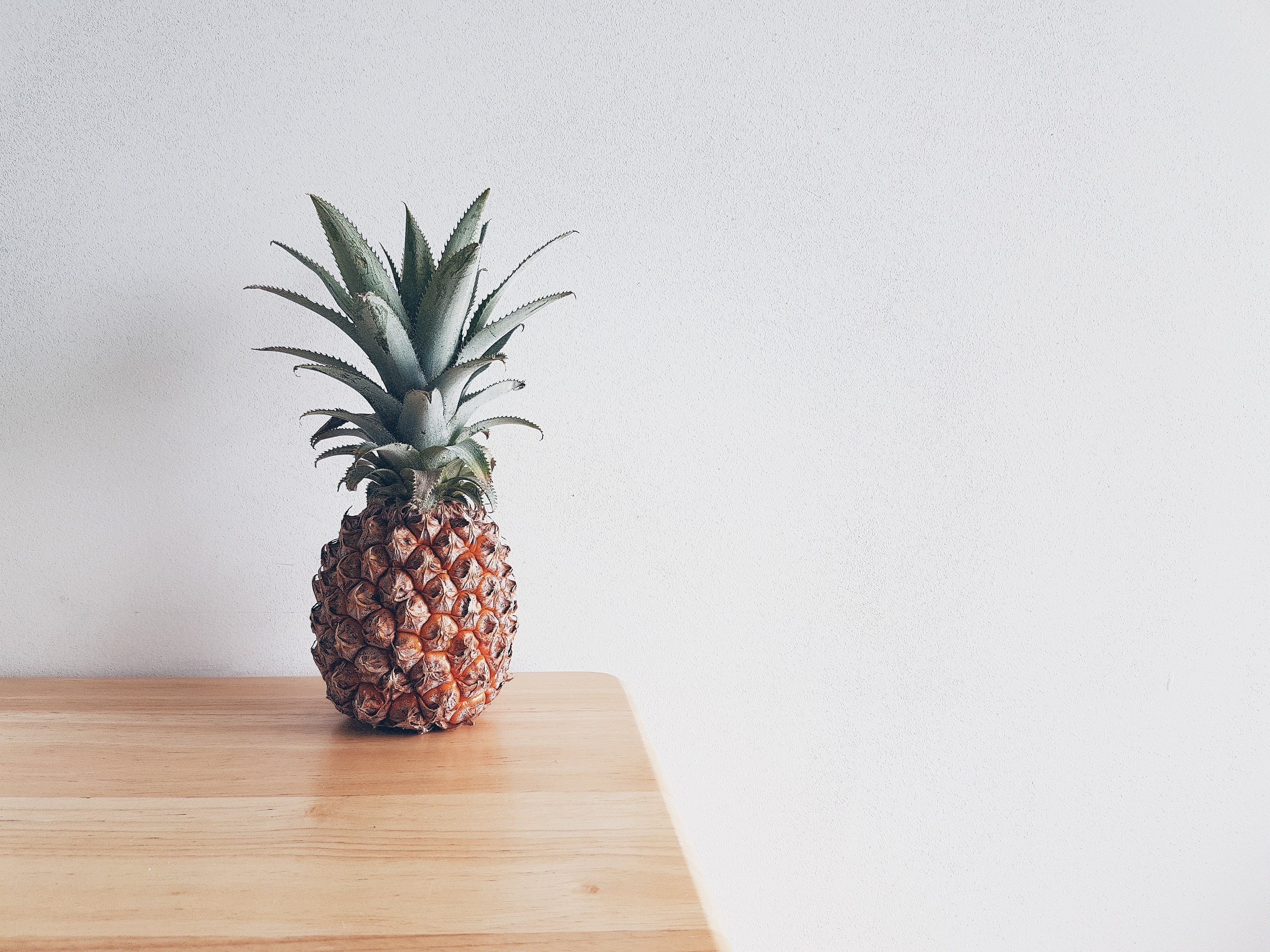 pineapple on beige wooden furniture
