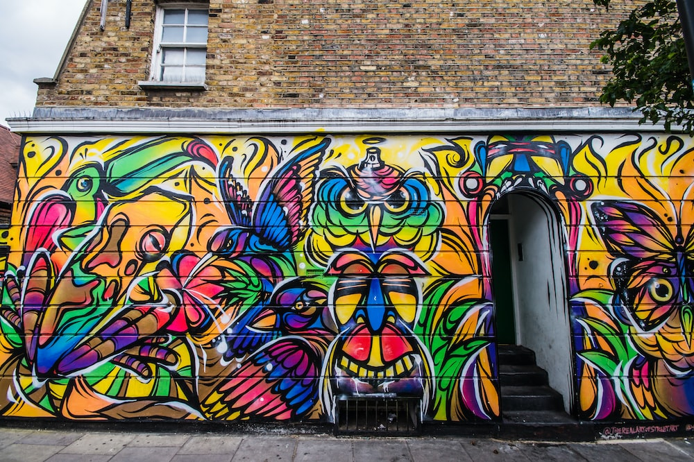 multicolored abstract graffiti on concrete buildings' wall during daytime