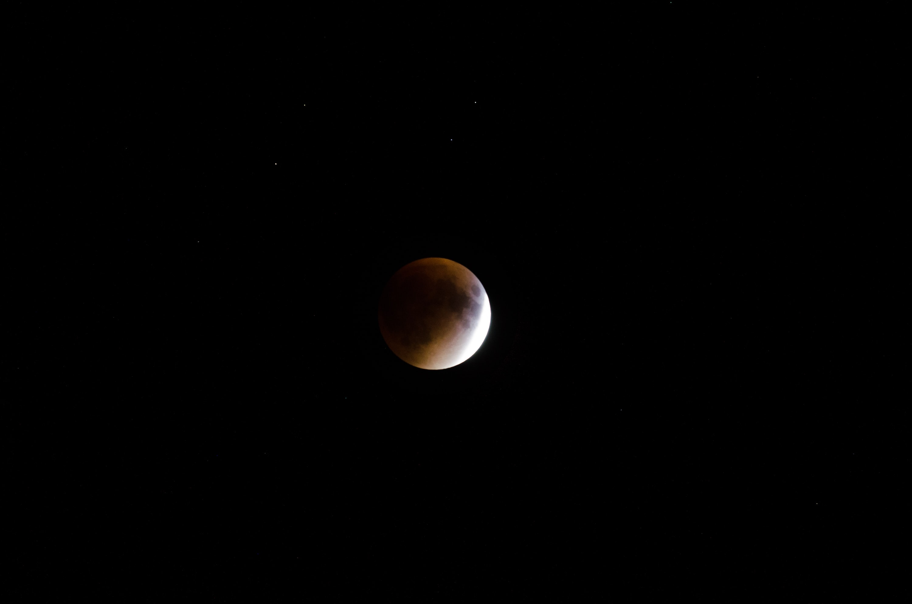 Red moon and stars on the night sky