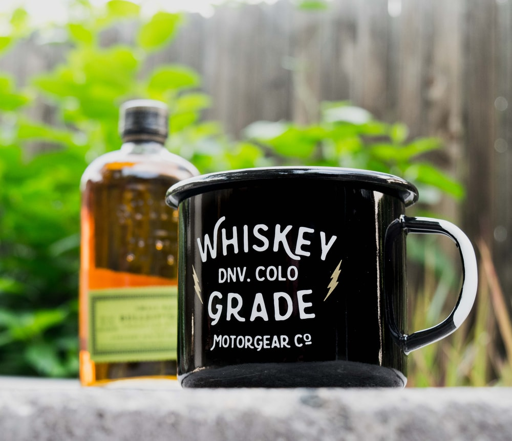 close-up photo of black and white Whiskey DNV. Cold Grade Motor Gear Co. mug