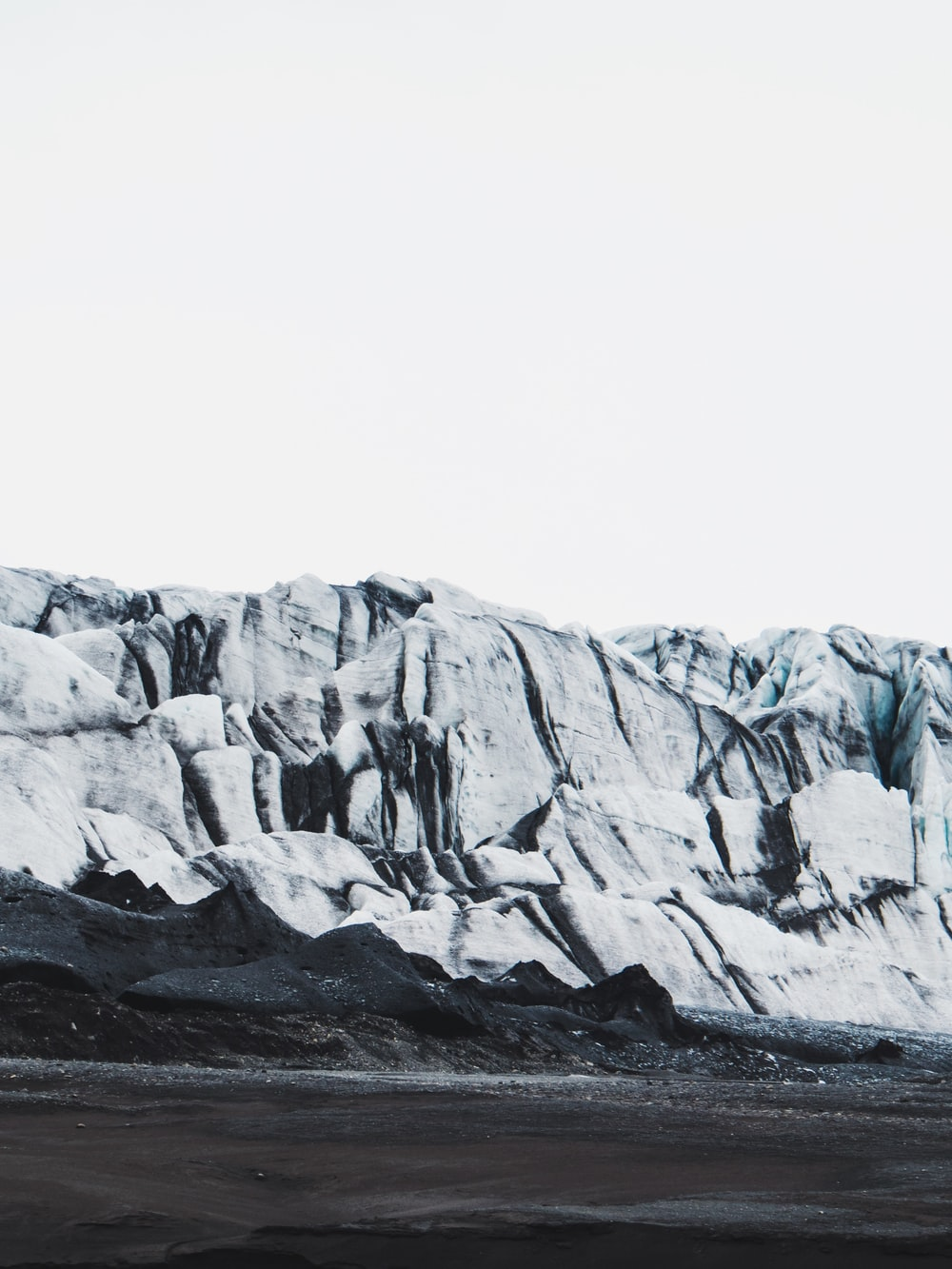 black sand near mountain during winter