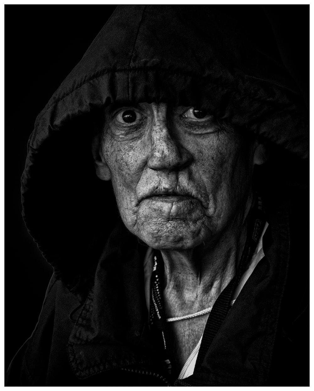 grayscale photo of man wearing black jacket