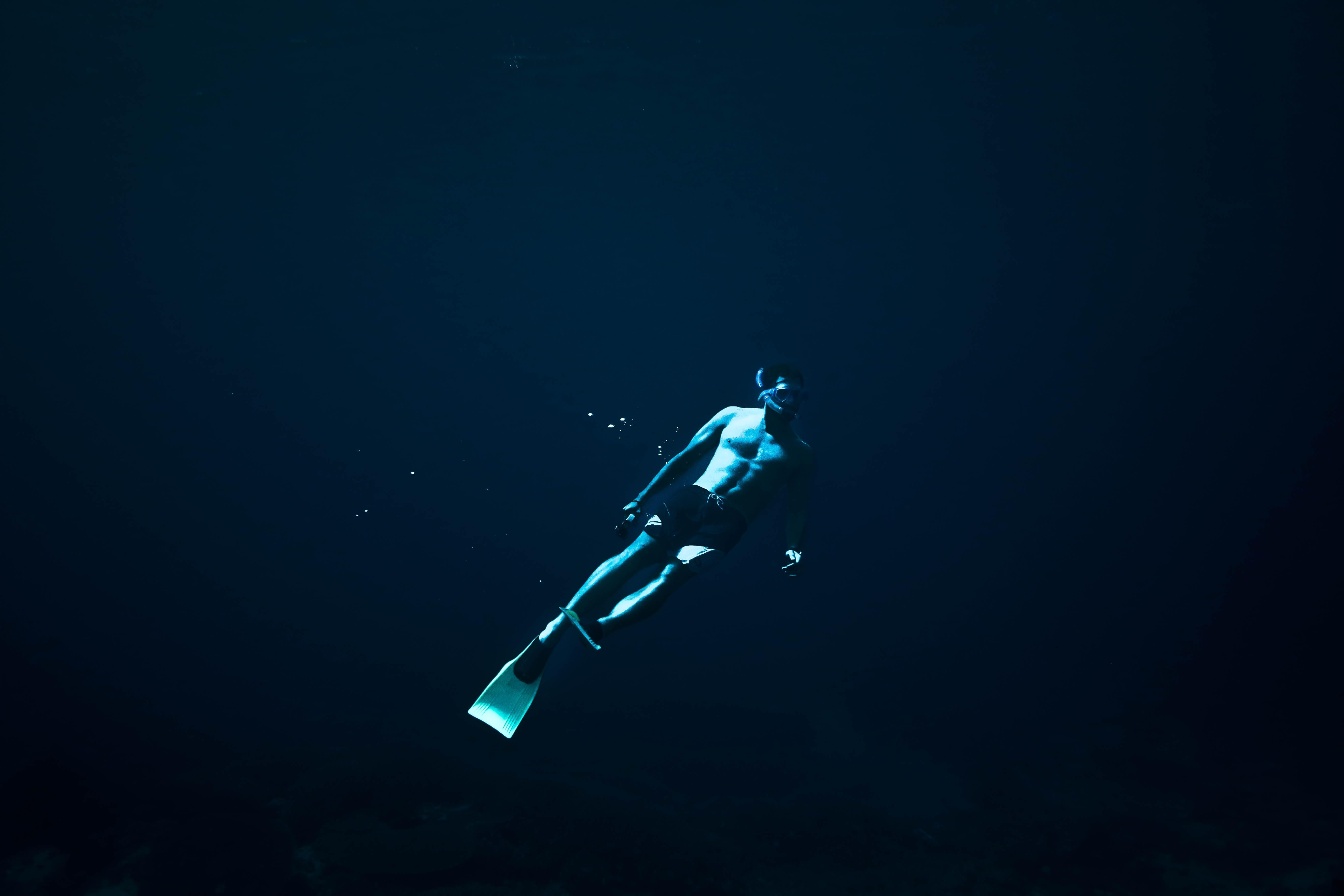 Underwater view of a man snorkeling in Lembongan Island.