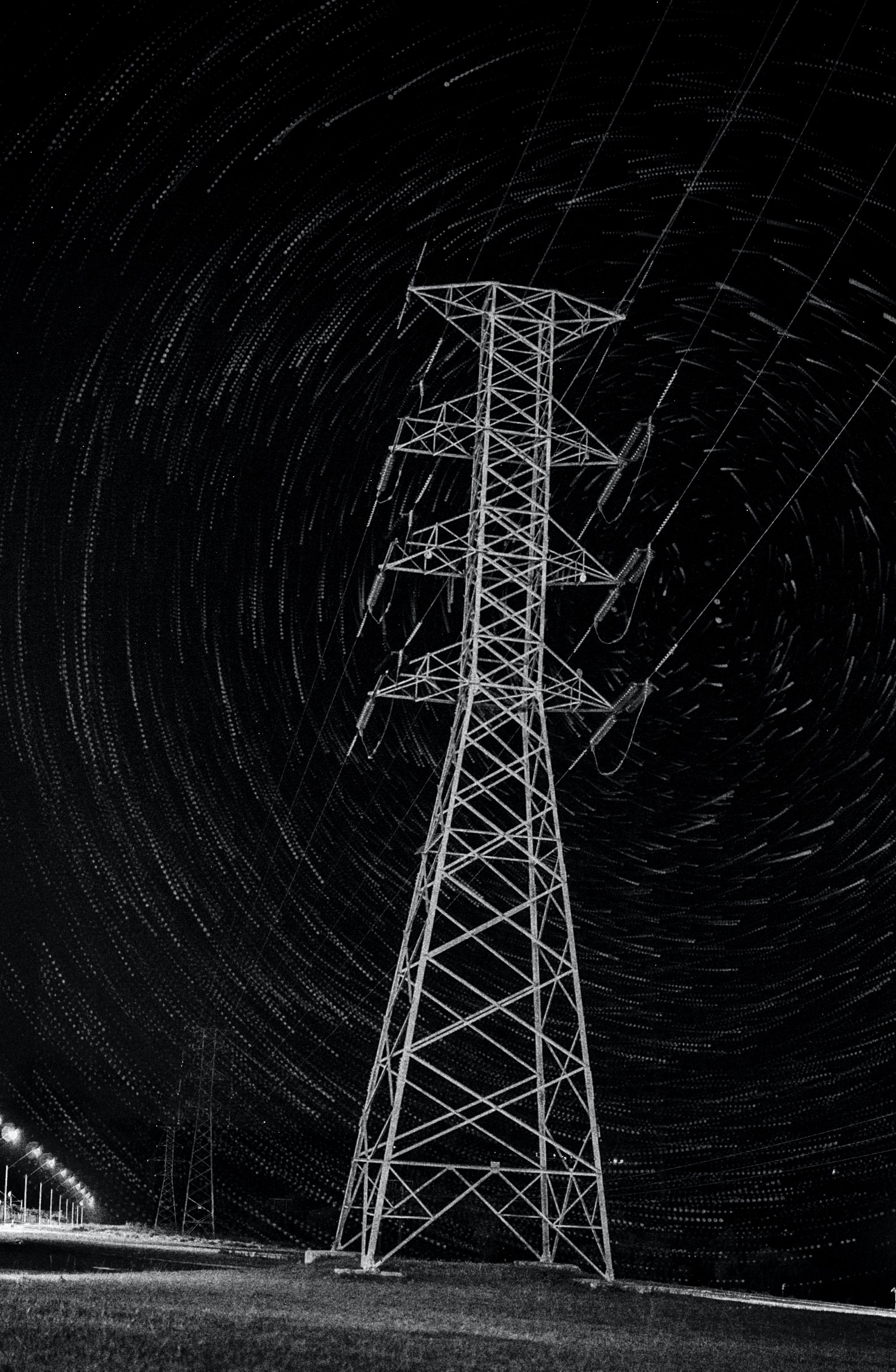 time lapse photography of transmission tower