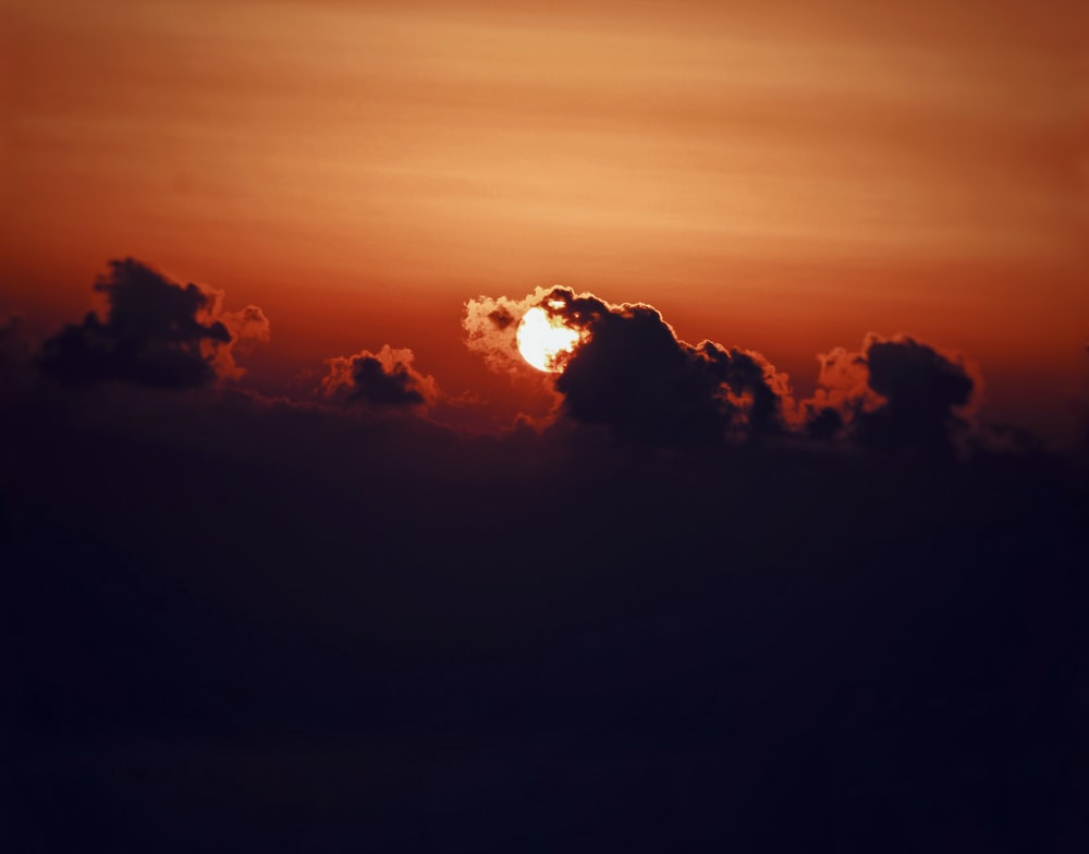 silhouette of clouds at sunset