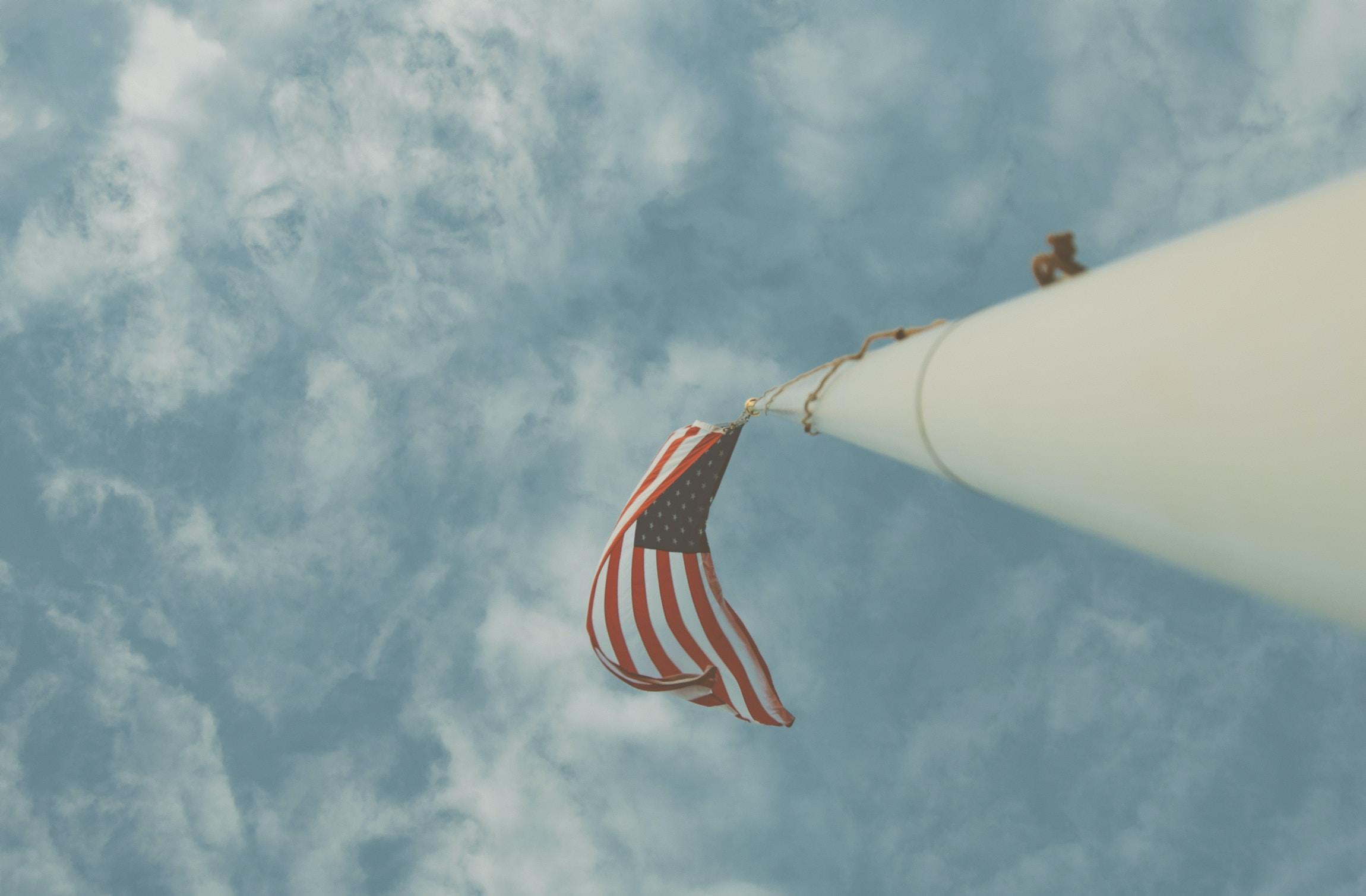 US flag on the flagpole on a clear day at Laguna Beach