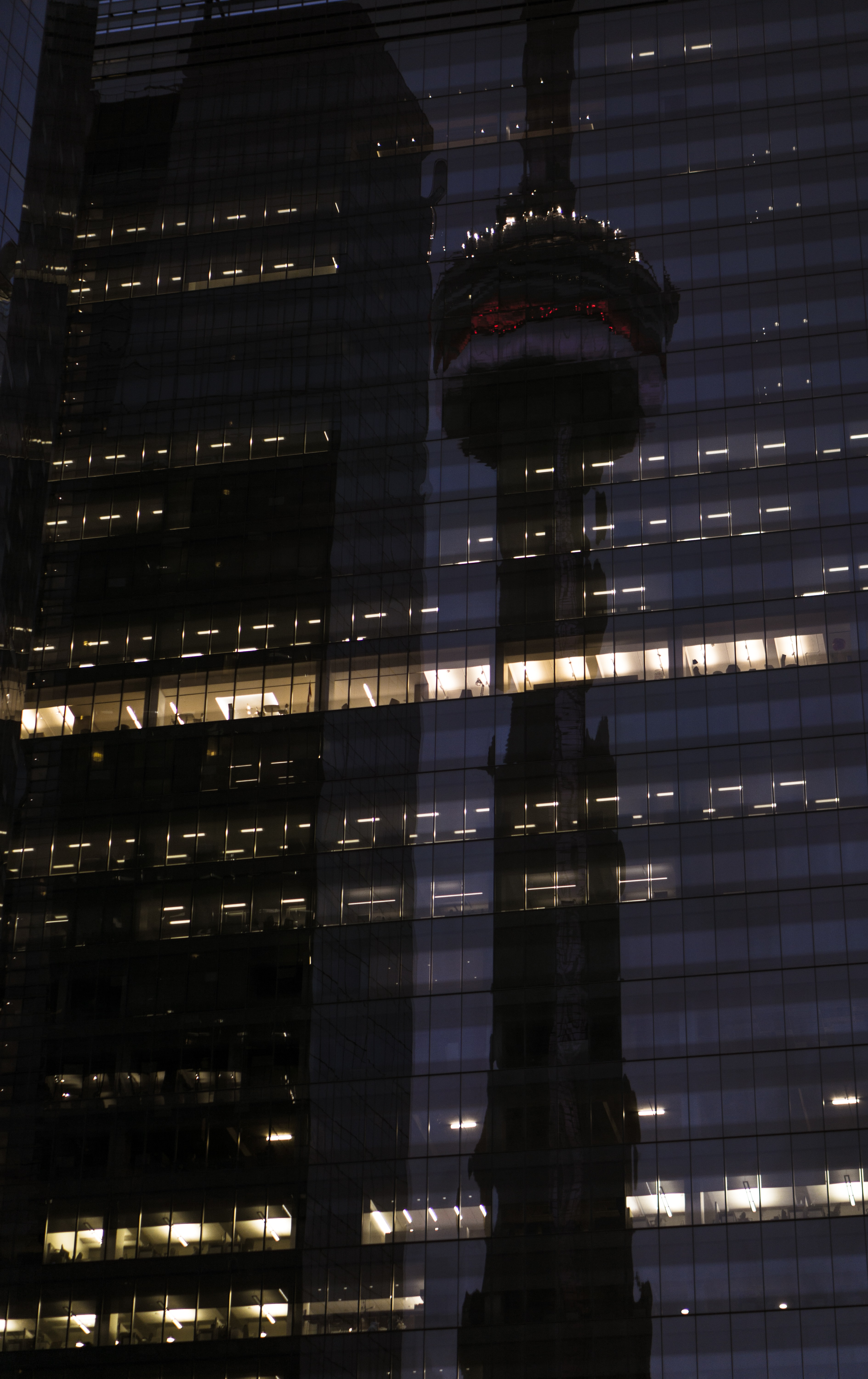 Reflection in the dark windows of a skyscrapers of the CN tower